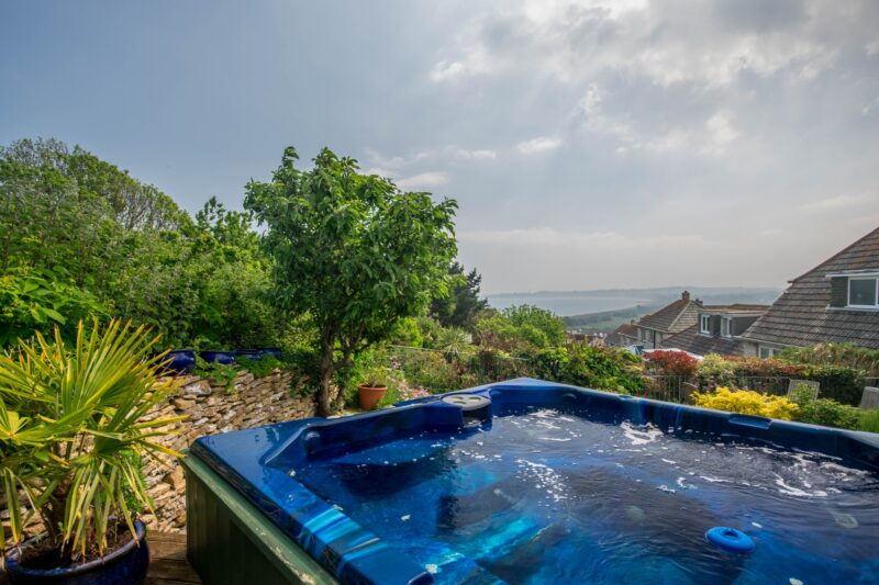 Enjoy views of Weymouth Bay from the hot tub